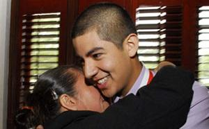 High School Honoree hugs his mother
