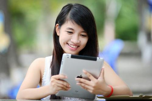 girl with book and computer