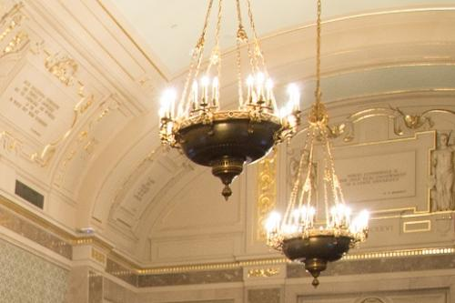 two large chandeliers hanging from the ceiling