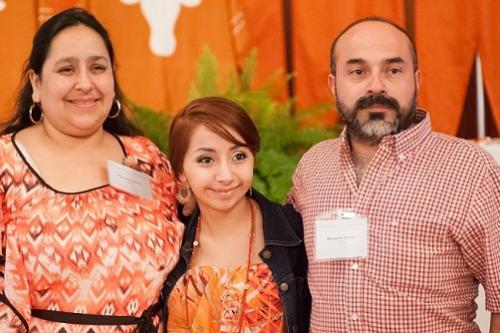 UT High School student and her parents all dress in orange to show school pride